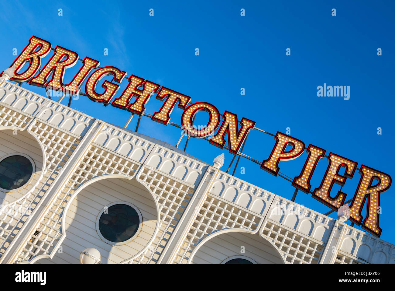 The lit-up neon sign on the historic Brighton Pier in East Sussx, UK. - Stock Image