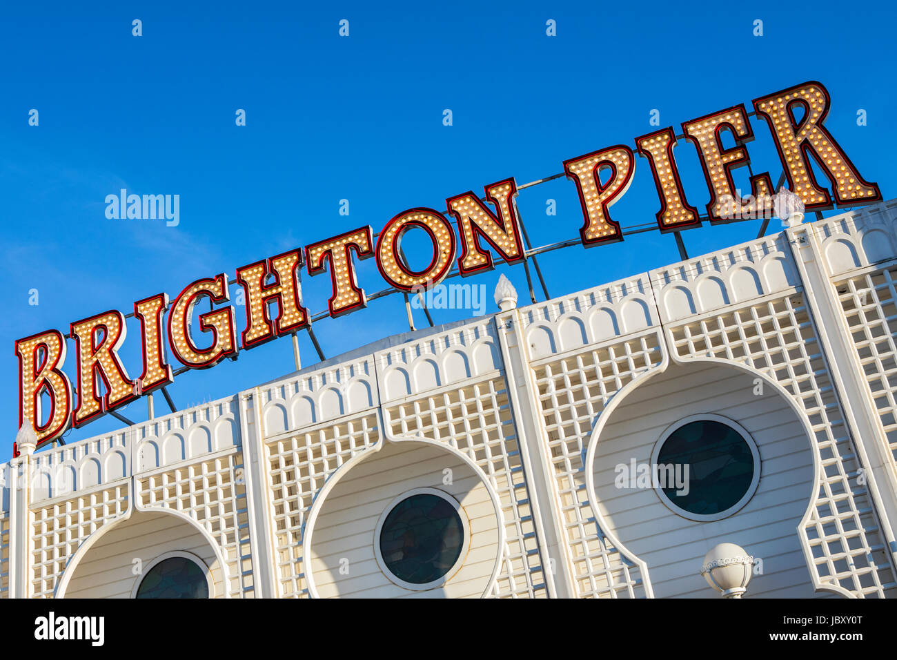 BRIGHTON, UK - MAY 31ST 2017: The lit-up neon sign on the historic Brighton Pier in East Sussex, UK, on 31st May - Stock Image