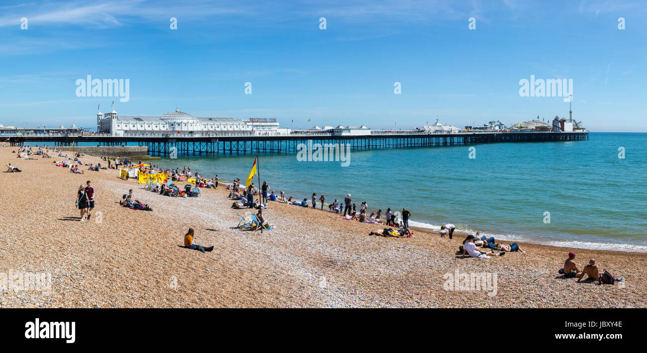 BRIGHTON, UK - MAY 31ST 2017: A view of the famous Brighton Pier and seafront in Sussex, UK, on 31st May 2017. - Stock Image