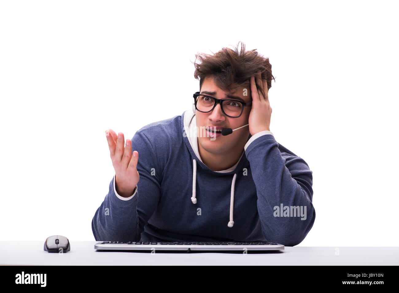 Funny nerd man working on computer isolated on white - Stock Image
