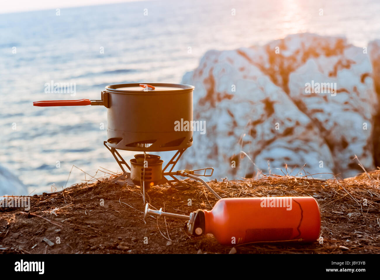 Tourist equipment and tools: camping gas over sea background Stock Photo