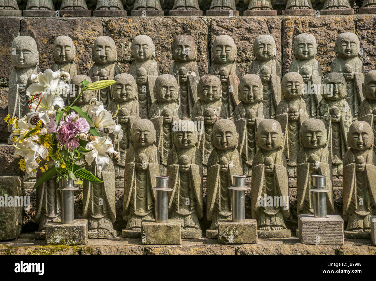 Jizo stone statues at the Hase-dera temple, commonly called the Hase-kannon, one of the Buddhist temples in Kamakura, - Stock Image