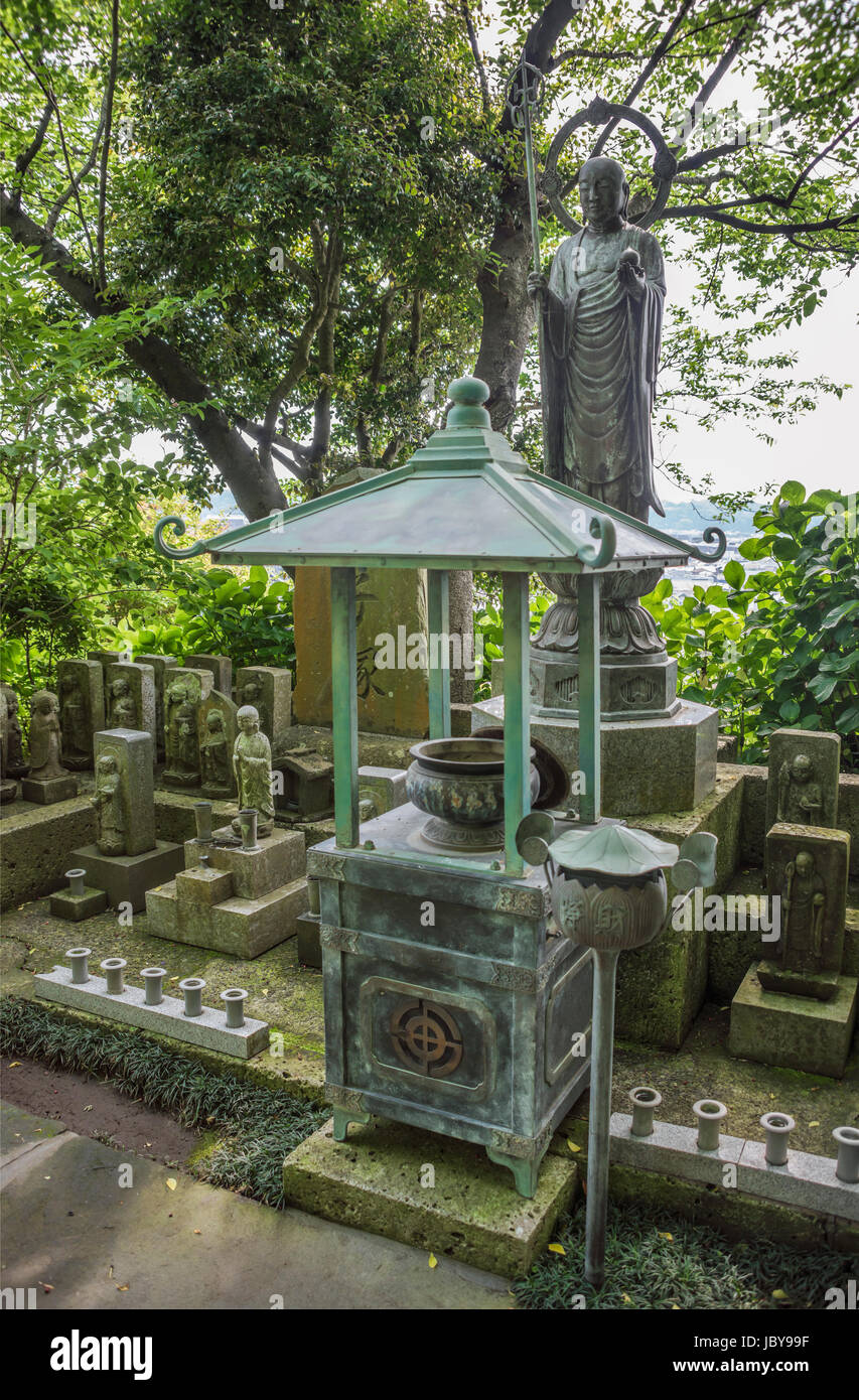 Monk statue at the garden of Hase-dera temple, commonly called the Hase-kannon, one of the Buddhist temples in Kamakura, - Stock Image