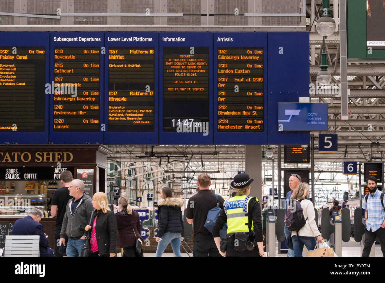 National Rail Security Campaign on Glasgow Central Station information board - See it, Say it, Sorted - Stock Image