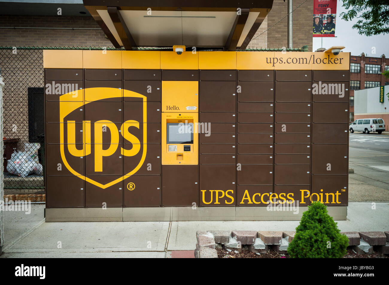a ups access point pick-up station in outside of a gas station in