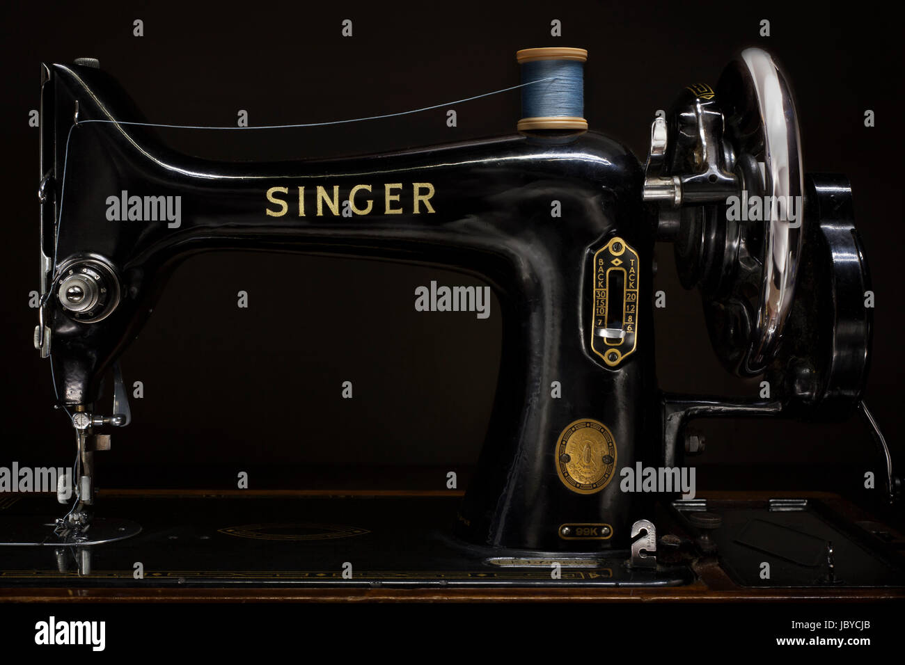 Beautiful product design from the early 1900's, the Singer 99K sewing machine was introduced in 1911 and stayed - Stock Image