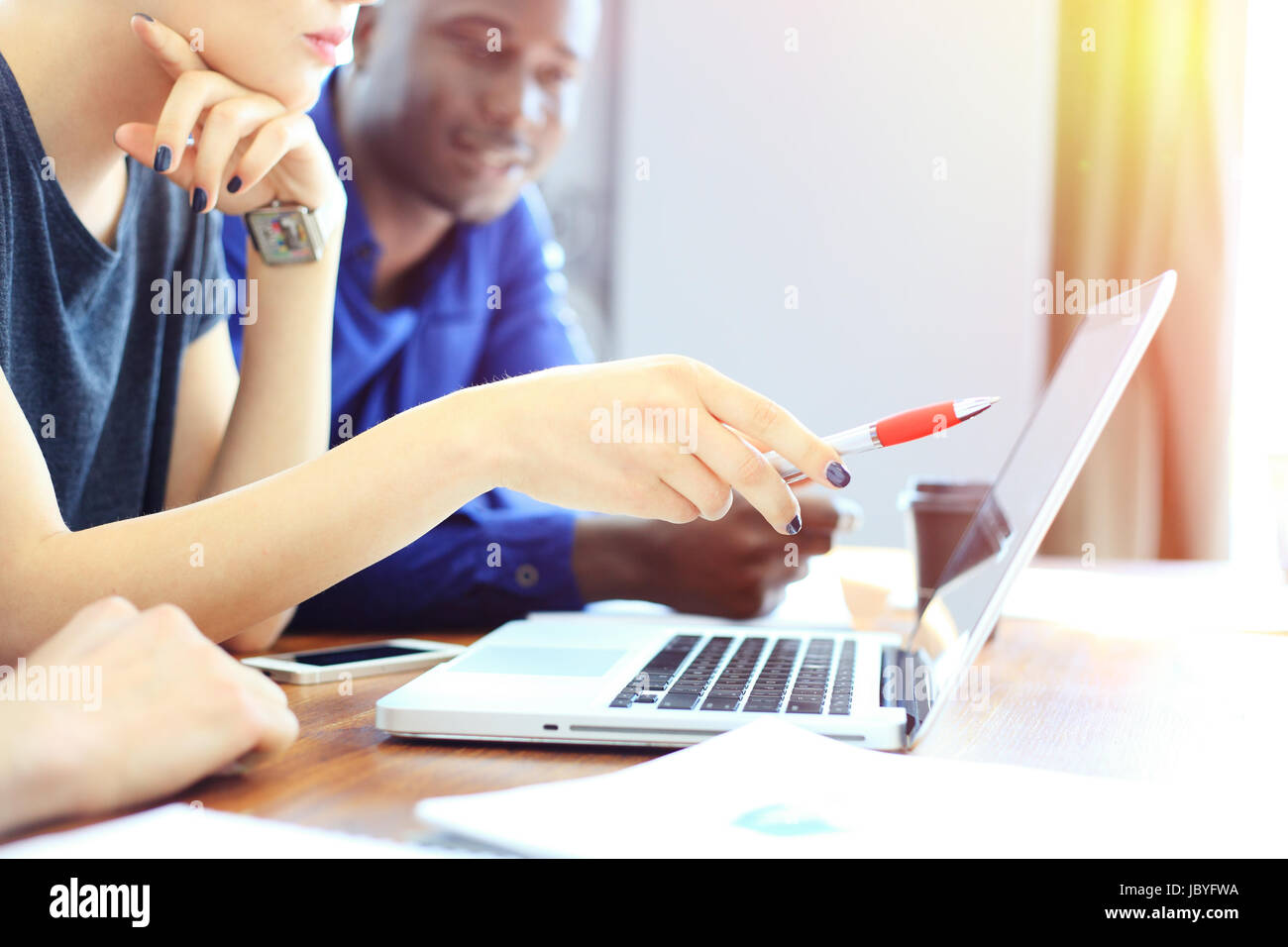 Teamwork,brainstorming concept.Young creative managers team working with new startup project in modern office. Contemporary - Stock Image