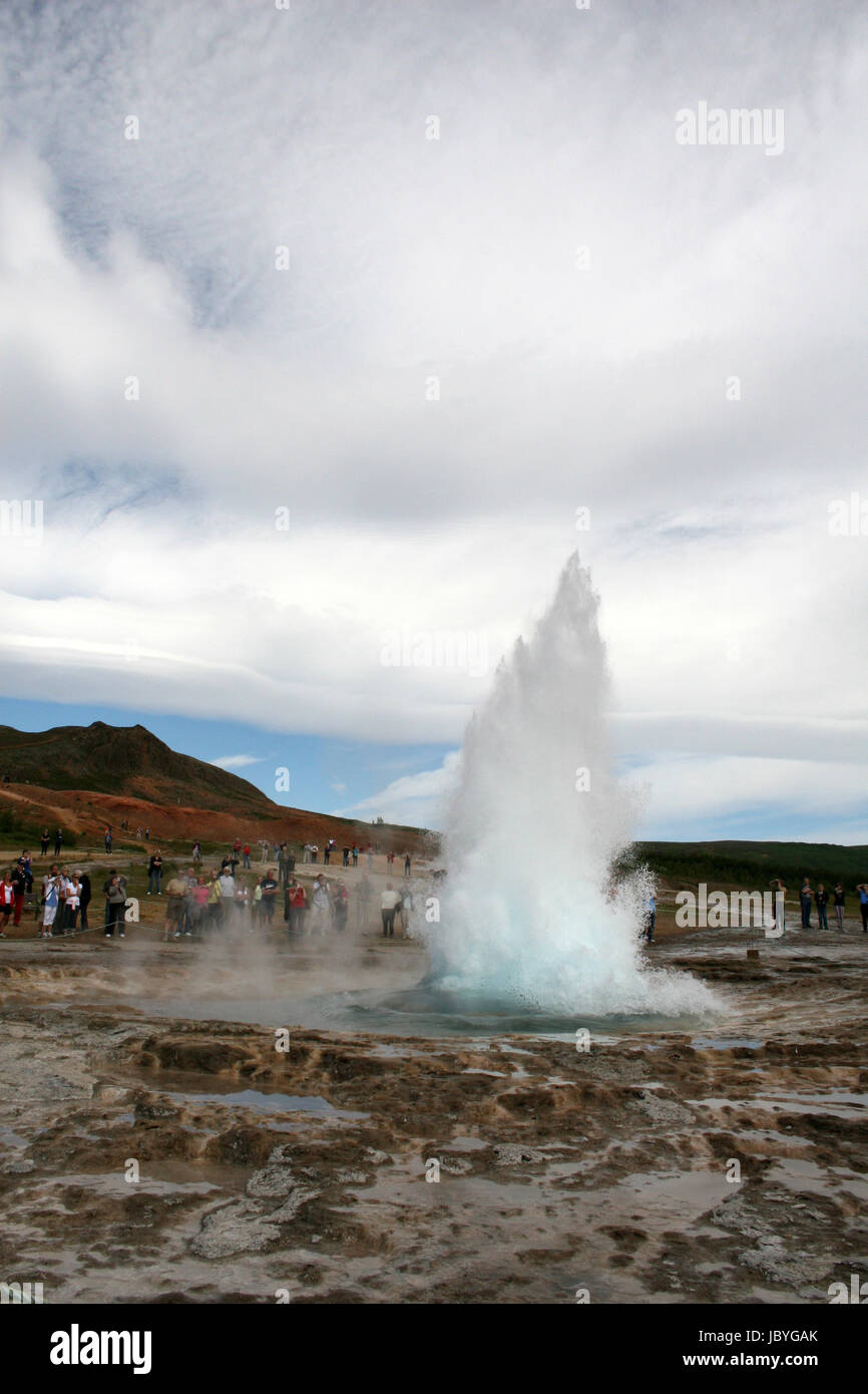 Bubble as fountain geyser starts erupting in geothermal area - Stock Image