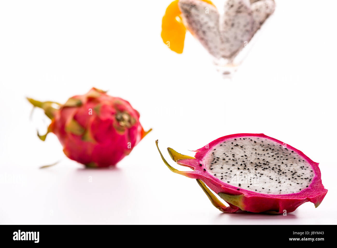 The blazing white and mildly aromatic pulp of the pitaya is suited for a quenching desert. Best served chilled. - Stock Image