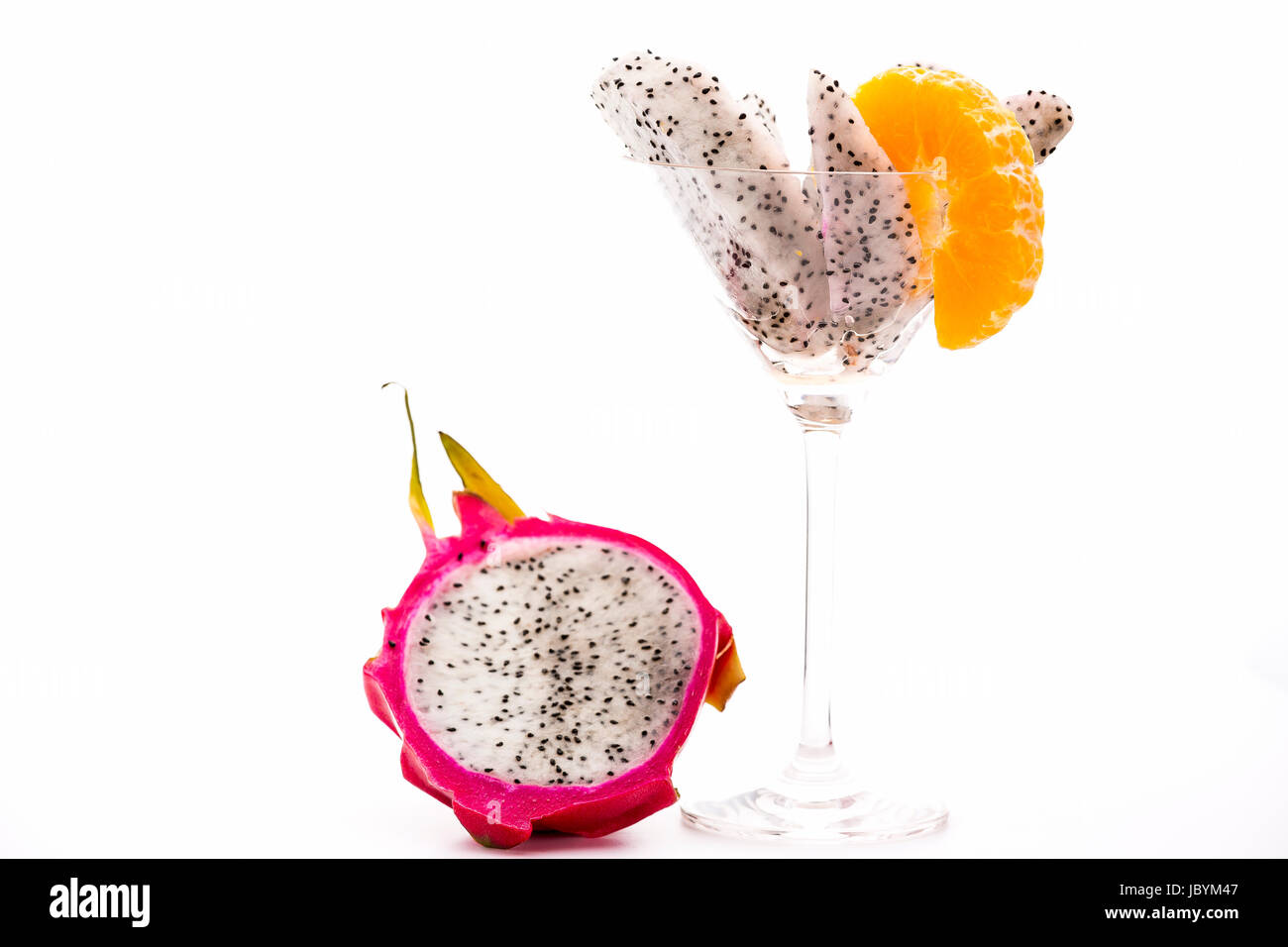 The white pulp of the pitaya presents itself splendidly clad in a vibrant purple skin. Its mild aroma is in harmony - Stock Image
