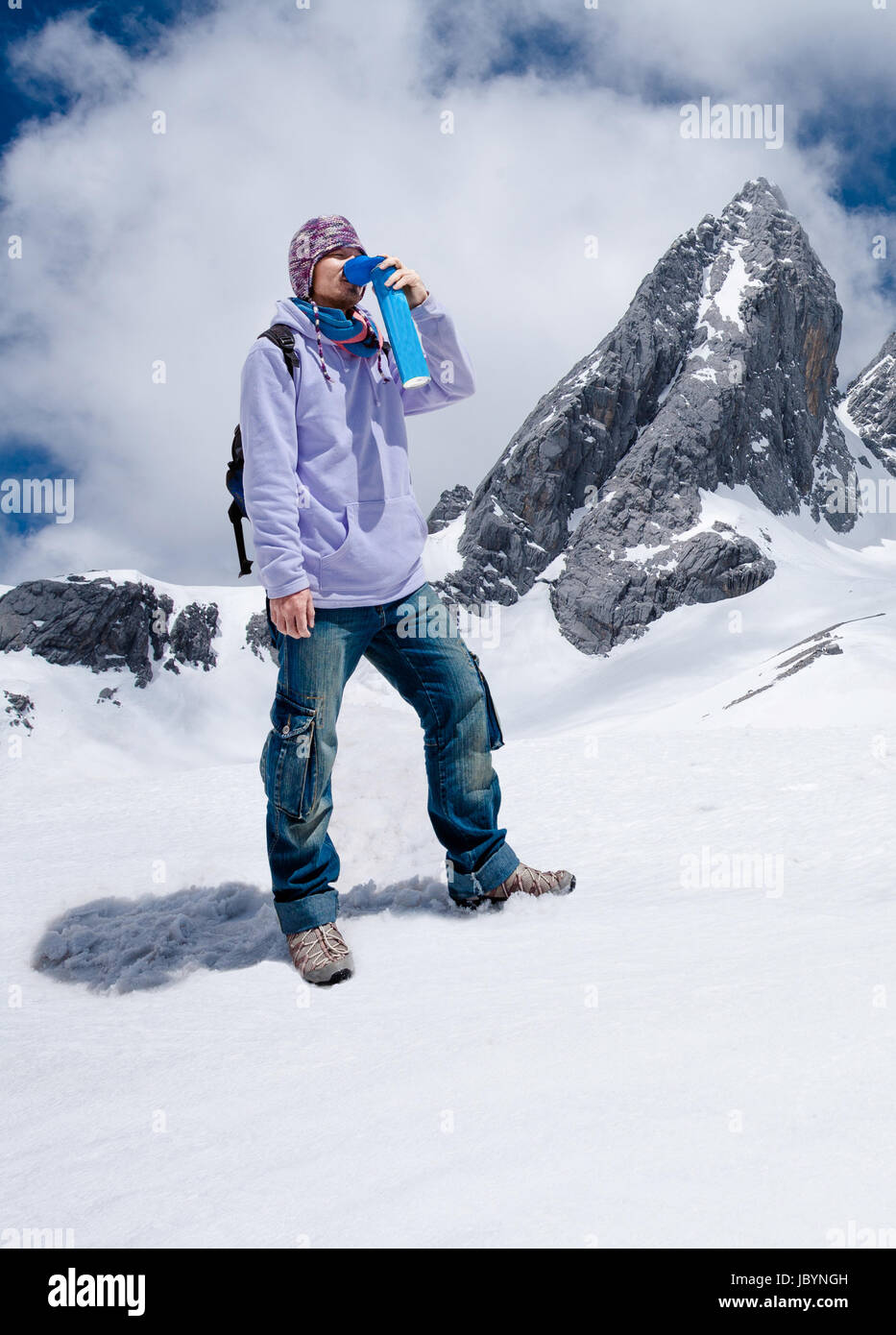 Climber Breathing With Mini Portable Oxygen Cylinder To Avoid And