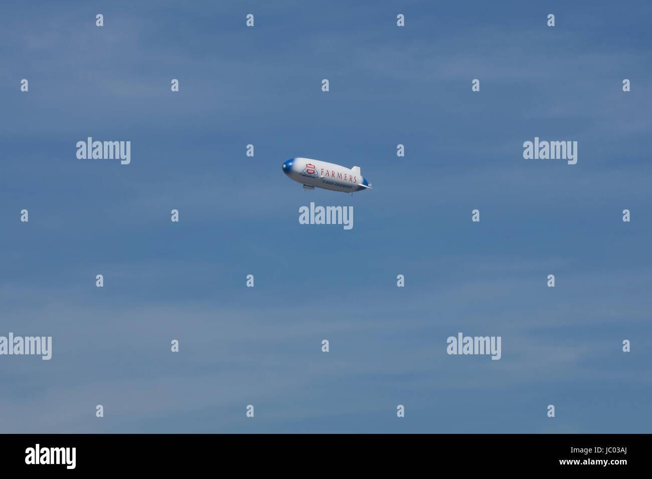 Farmers Insurance company advertisement  blimp aircraft - USA - Stock Image