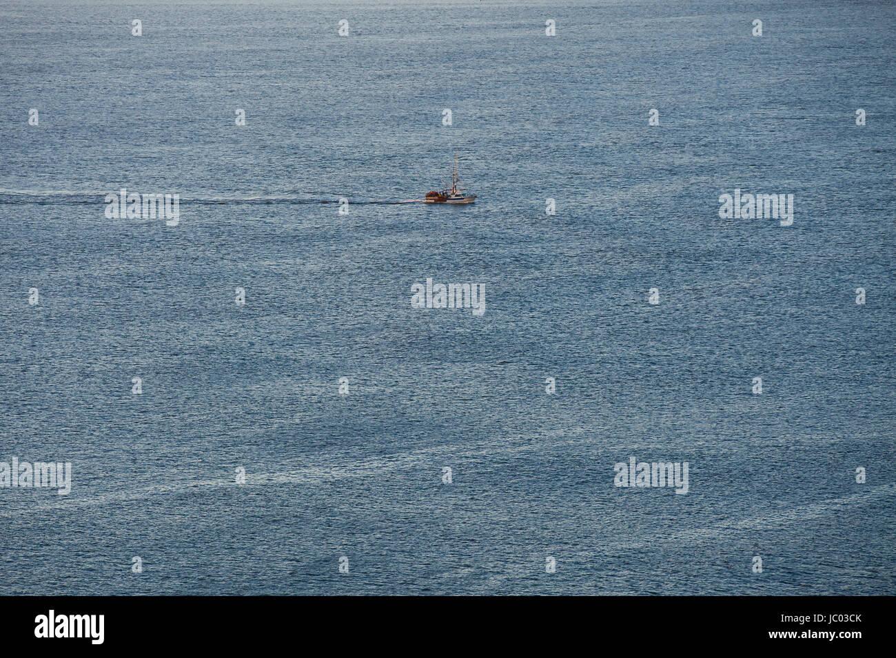 Crab fishing boat on open water (ocean water) - San Francisco, California USA - Stock Image