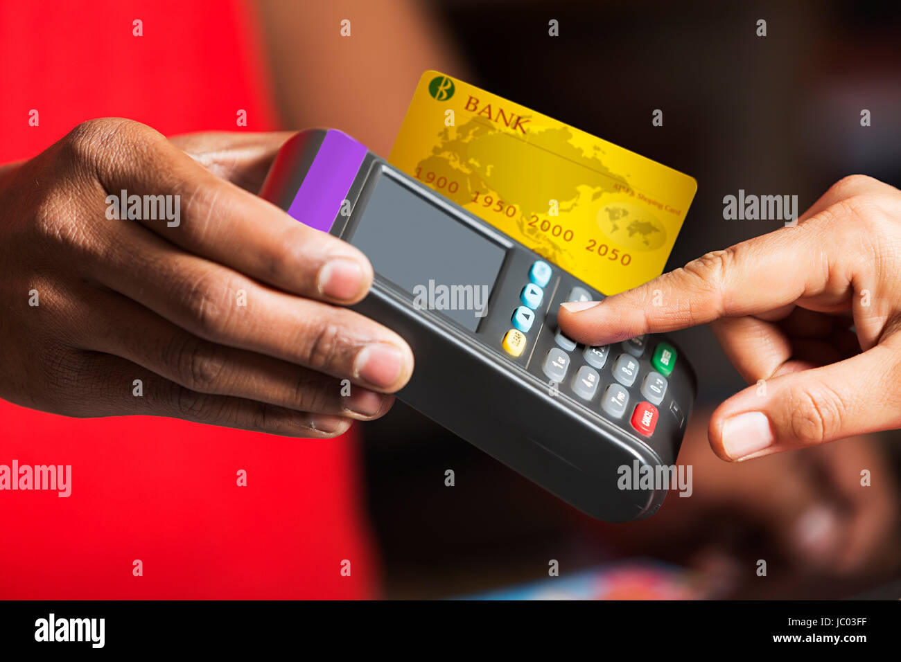 Shopkeeper and customer credit card swiping on swipe machine product shopkeeper and customer credit card swiping on swipe machine product buying in shop reheart Images
