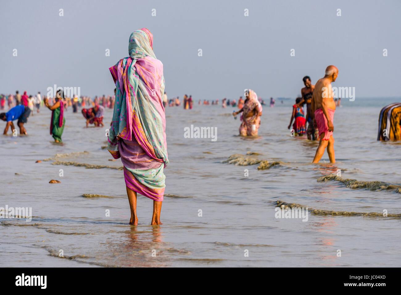 Hundreds of pilgrims are gathering on the beach of Ganga Sagar, celebrating Maghi Purnima festival Stock Photo