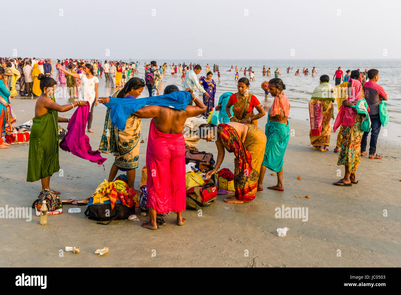 Hundreds of pilgrims are gathering on the beach of Ganga Sagar, celebrating Maghi Purnima festival Stock Photo