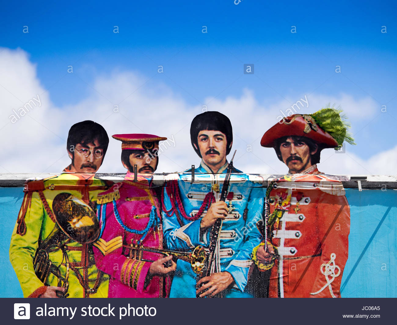 The Beatles on an unusual billboard in central London for the 50th anniversary relaunch of the Sgt Peppers album - Stock Image