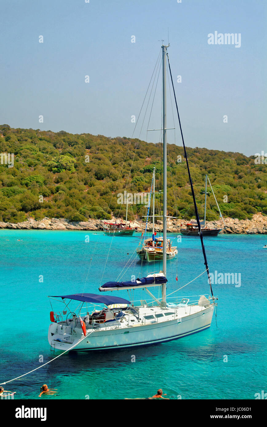 Cruising yacht at anchor in Poyraz bay, Karaada, near Bodrum Turkey. - Stock Image