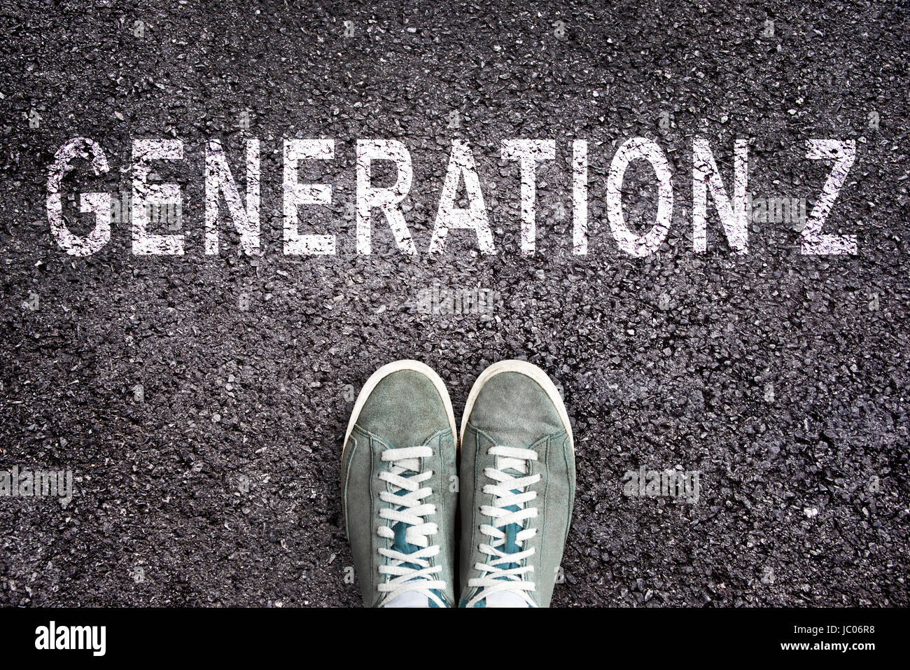 Text Generation Z written on asphalt with shoes, generation Z concept - Stock Image