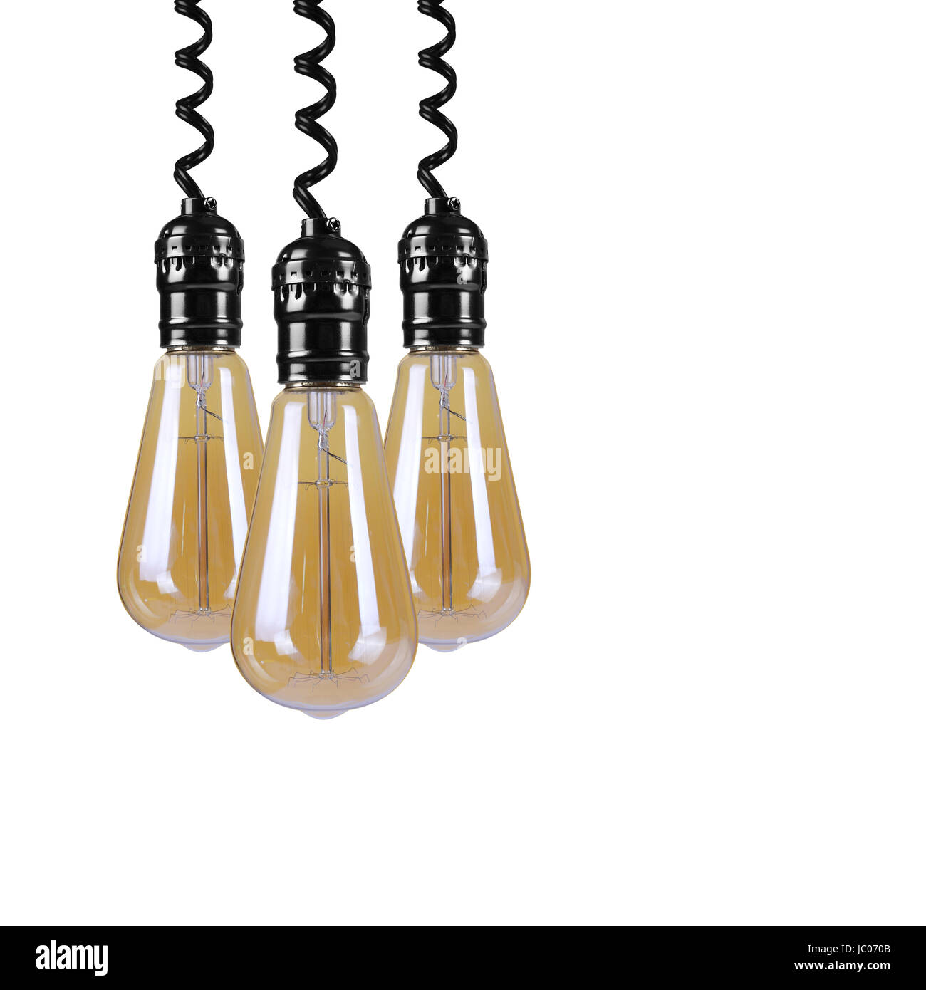 Three Incandescent light bulb hangs down on top on a white background. - Stock Image
