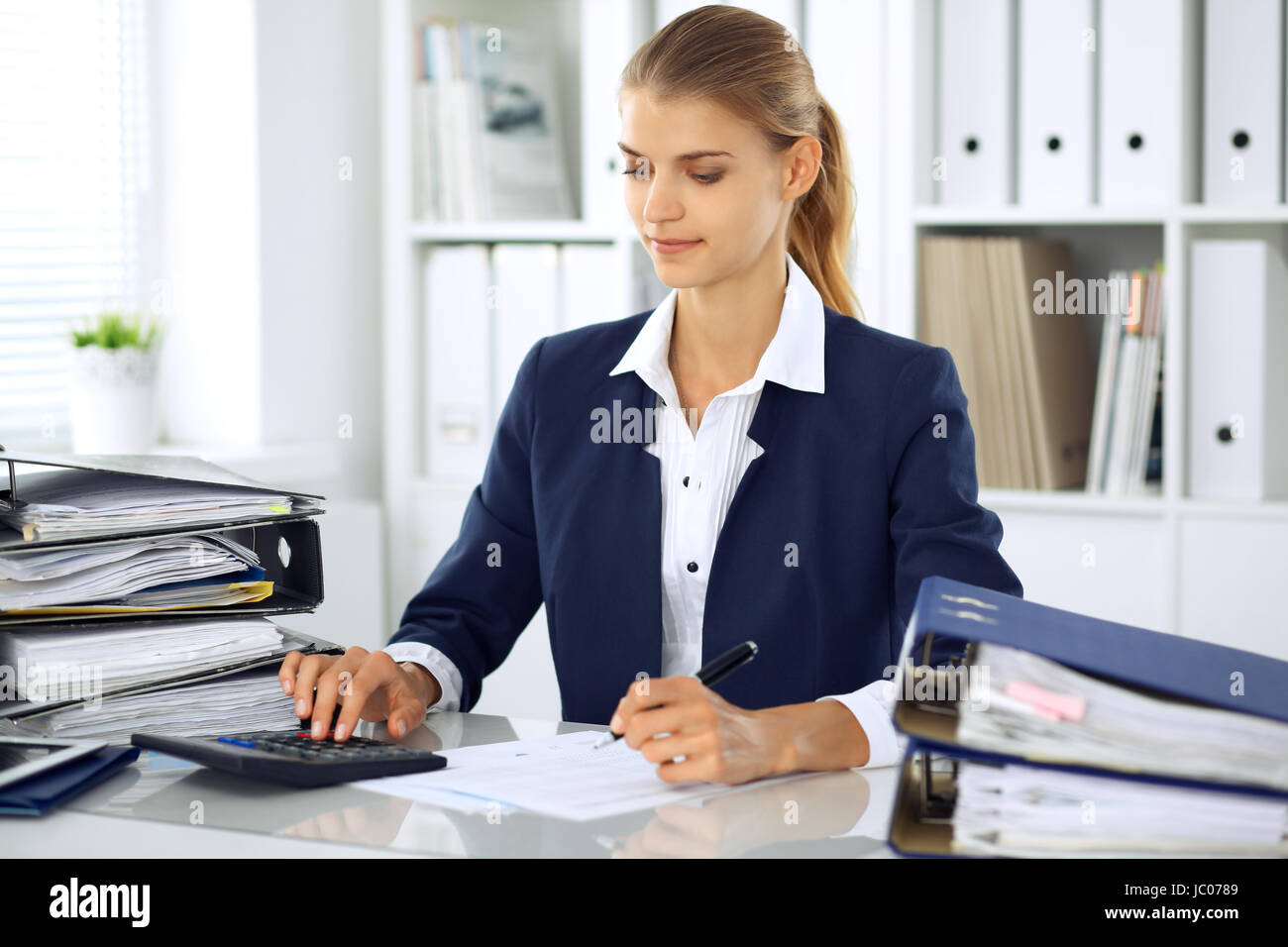 Modern business woman or confident female accountant in office. Student girl during exam preparing. Audit, tax service - Stock Image