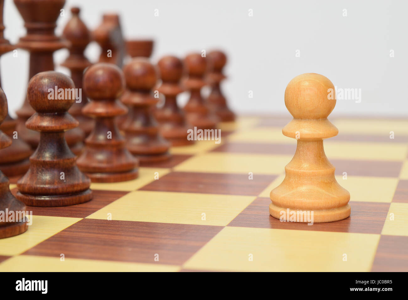 White pawn in front of the black lining Stock Photo
