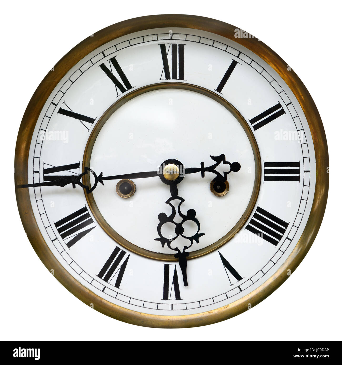 antique clock face showing the time sixteen to six isolated on