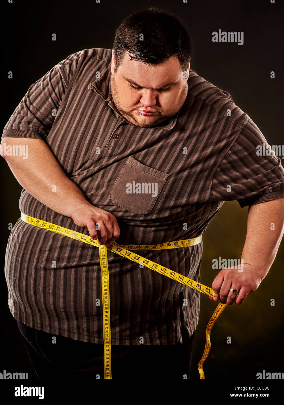 Man belly fat with tape measure weight loss around body on