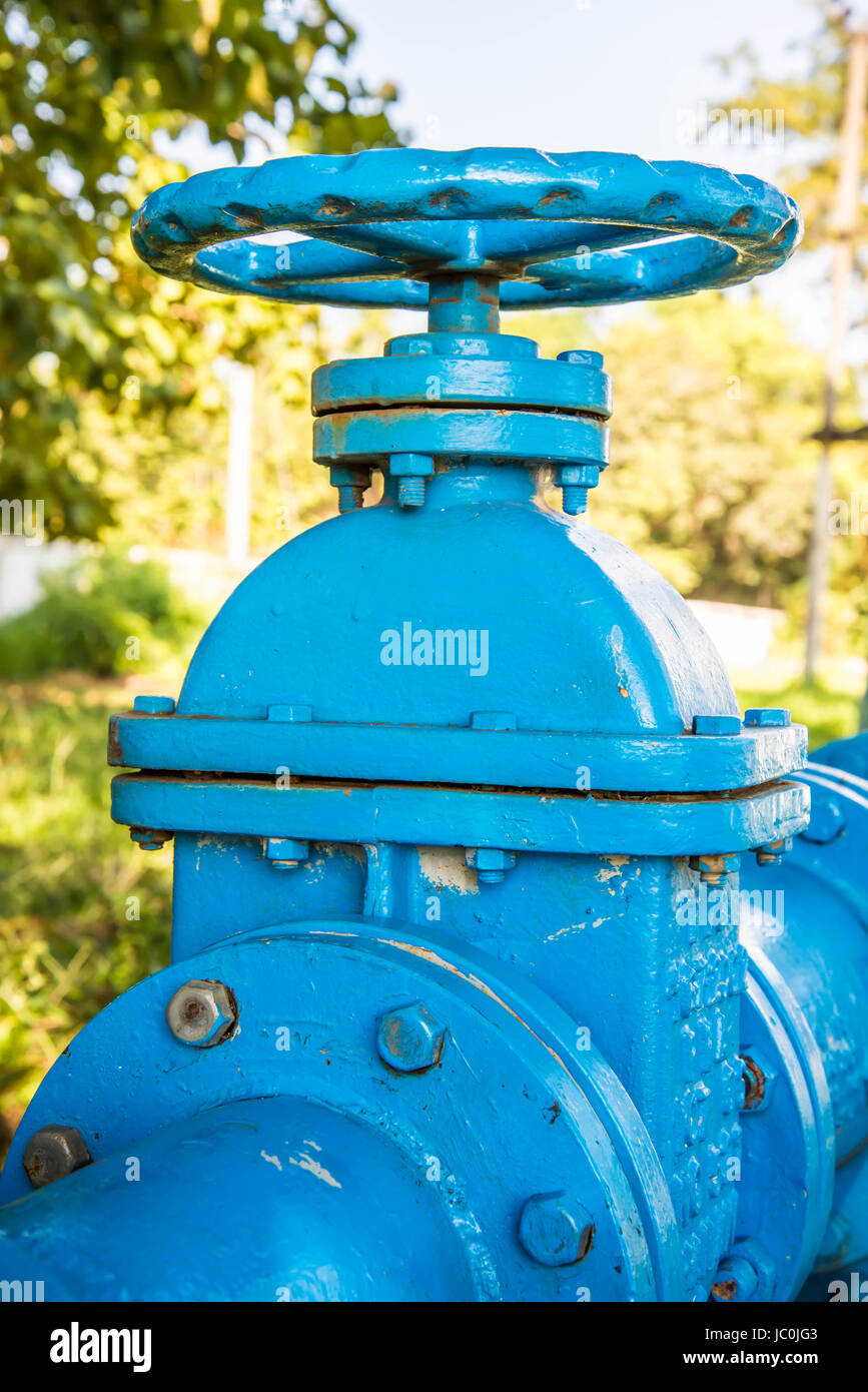 A gate valve in the water supply system of the factory. - Stock Image