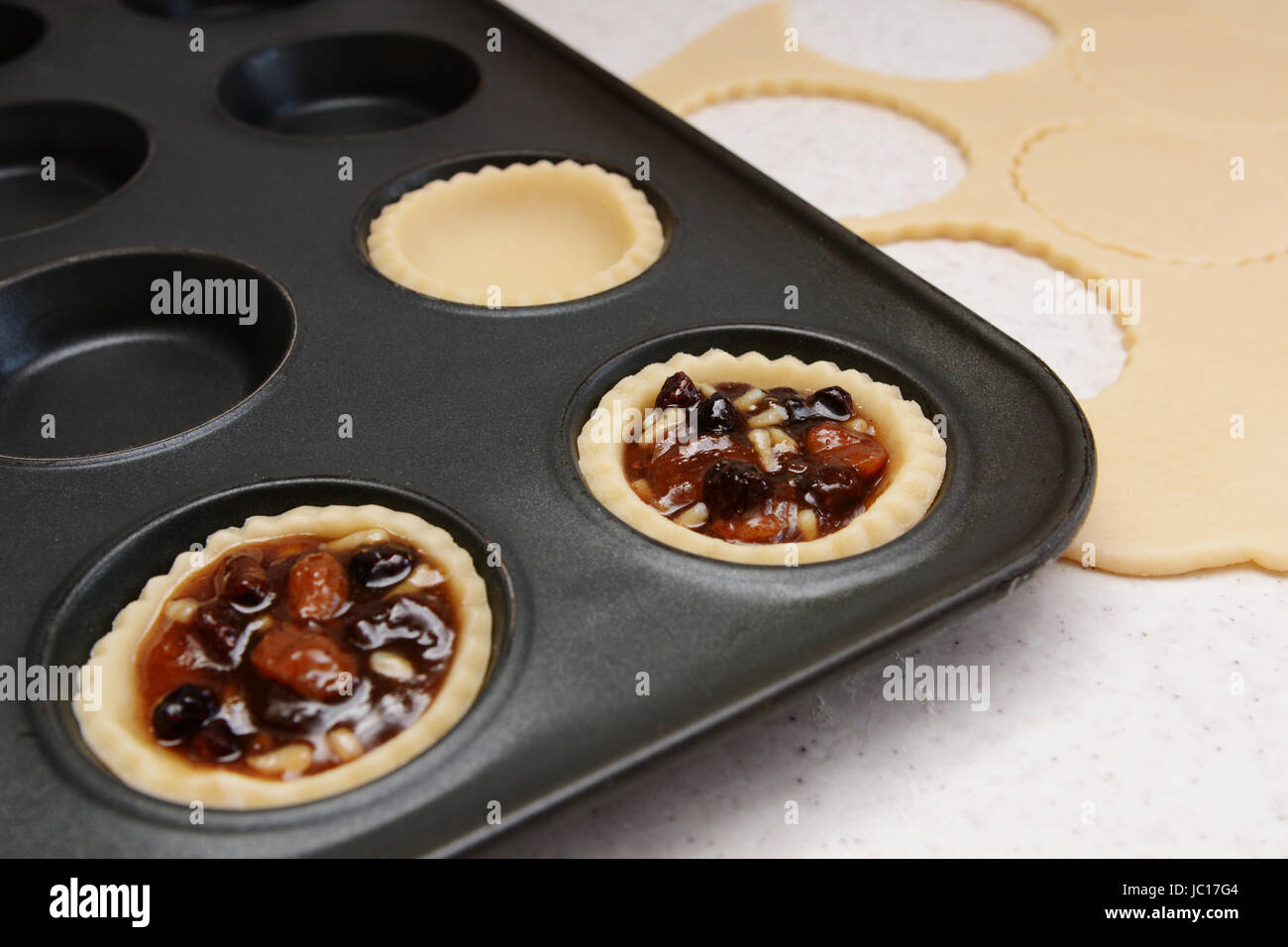 Making mince pies - pastry cases filled with traditional mincemeat Stock Photo