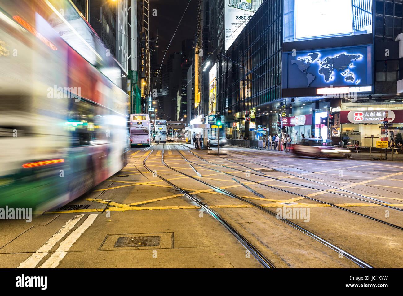HONG KONG - APRIL 21, 2017: a Bus rushES through Central in Hong Kong island at night in China Hong Kong SAR. This - Stock Image