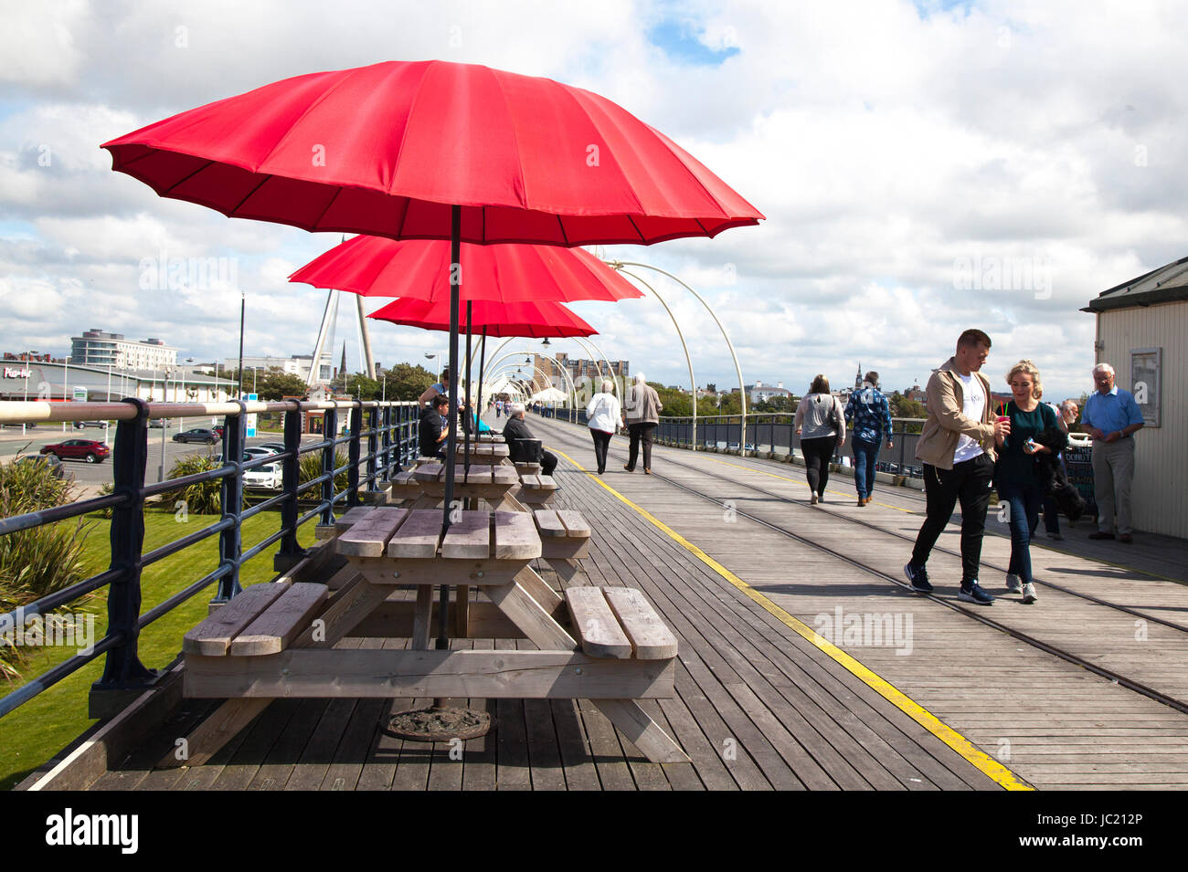 Southport, Merseyside, UK. UK Weather. 13th June, 2017. Sun breaks through in the north-west resort as pier seaside - Stock Image