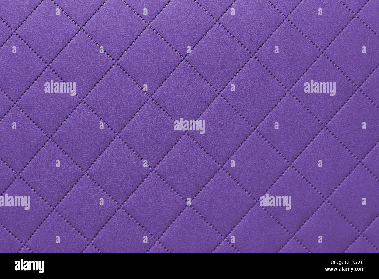 detail of sewn leather, purple leather upholstery background pattern - Stock Image