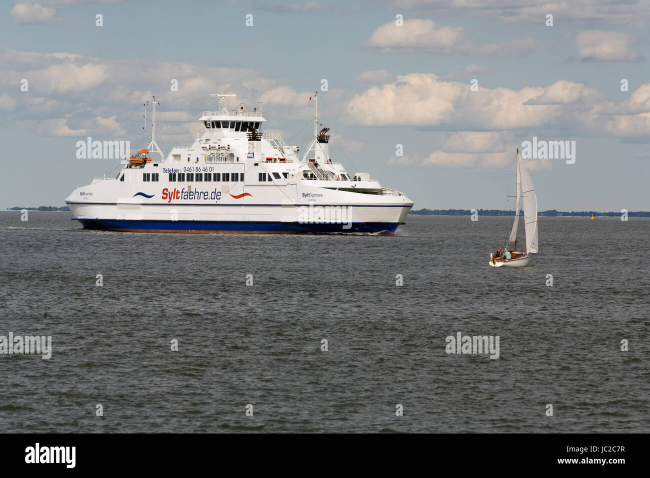 List, Germany, the double-ended ferry SyltExpress in the North Sea off Sylt - Stock Image