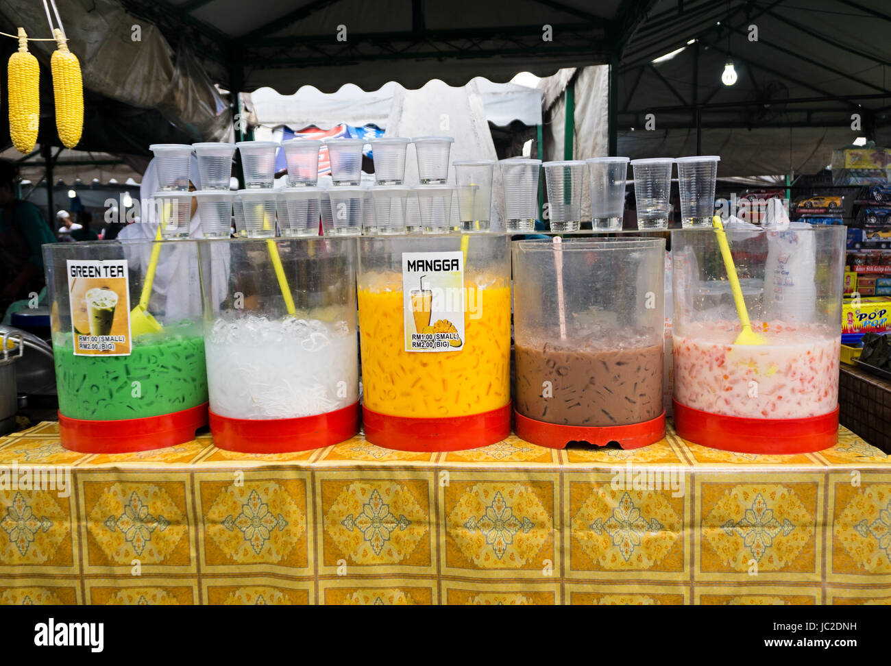 KOTA KINABALU, SABAH, MALAYSIA - JUNE 10, 2017: Night market stall selling variety of juices with different flavor. - Stock Image