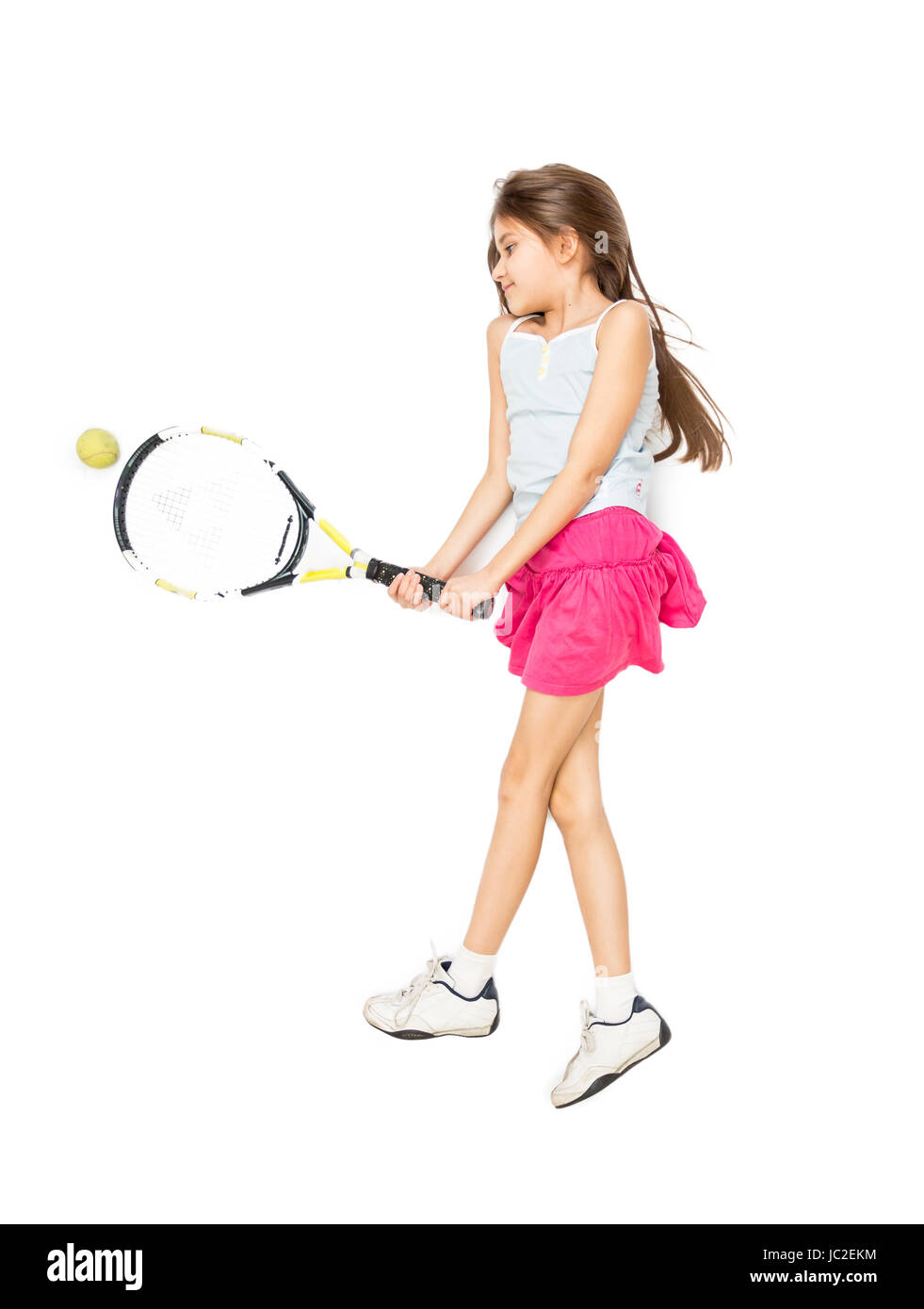 Isolated photo from high point of view of cute girl lying on floor and playing tennis - Stock Image