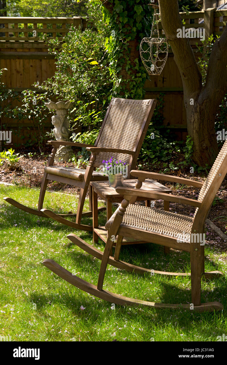 Awesome Wooden Wicker Rocking Chairs In Shady English Garden Stock Squirreltailoven Fun Painted Chair Ideas Images Squirreltailovenorg