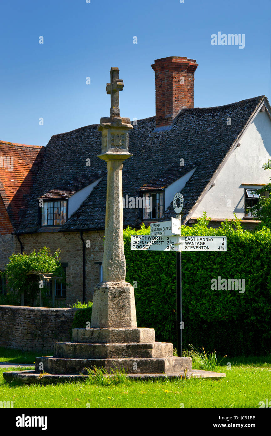 war memorial street sign and cottage in East Hanney village,Oxfordshire,England - Stock Image