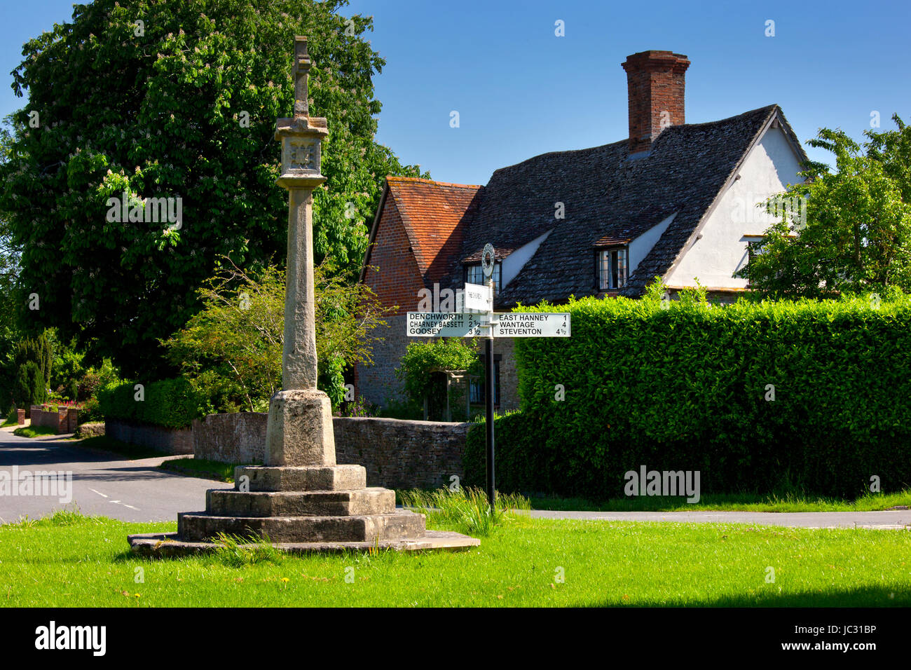 village green, war memorial and street sign in village of West Hanney, Oxfordshire,England - Stock Image
