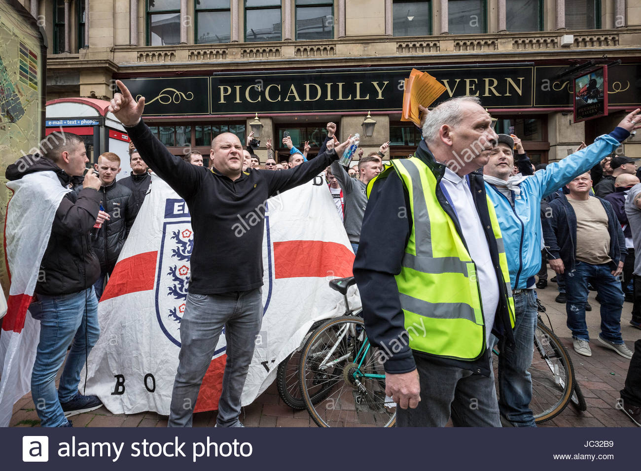 About 1,000 attend right-wing 'Unite Against Hate' anti-Islamic march and rally lead by Tommy Robinson in Manchester - Stock Image