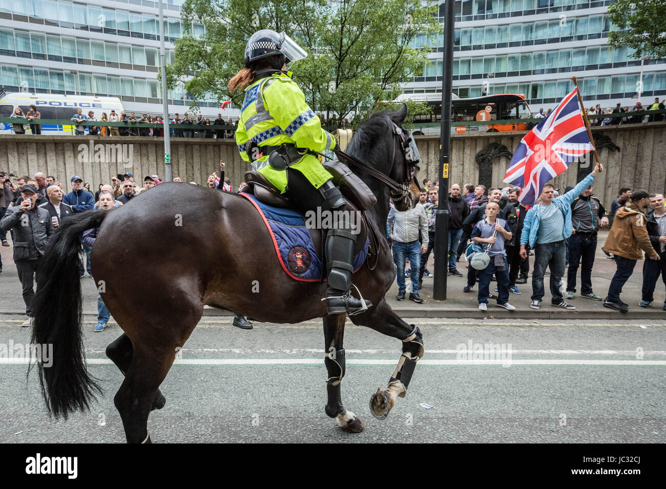 About 1,000 attend right-wing 'Unite Against Hate' anti-Islamic march and rally lead by Tommy Robinson in Manchester Stock Photo