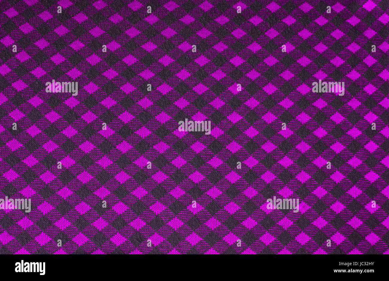 Knitted (tricot) background, emo style, with black and pink rhombuses - Stock Image