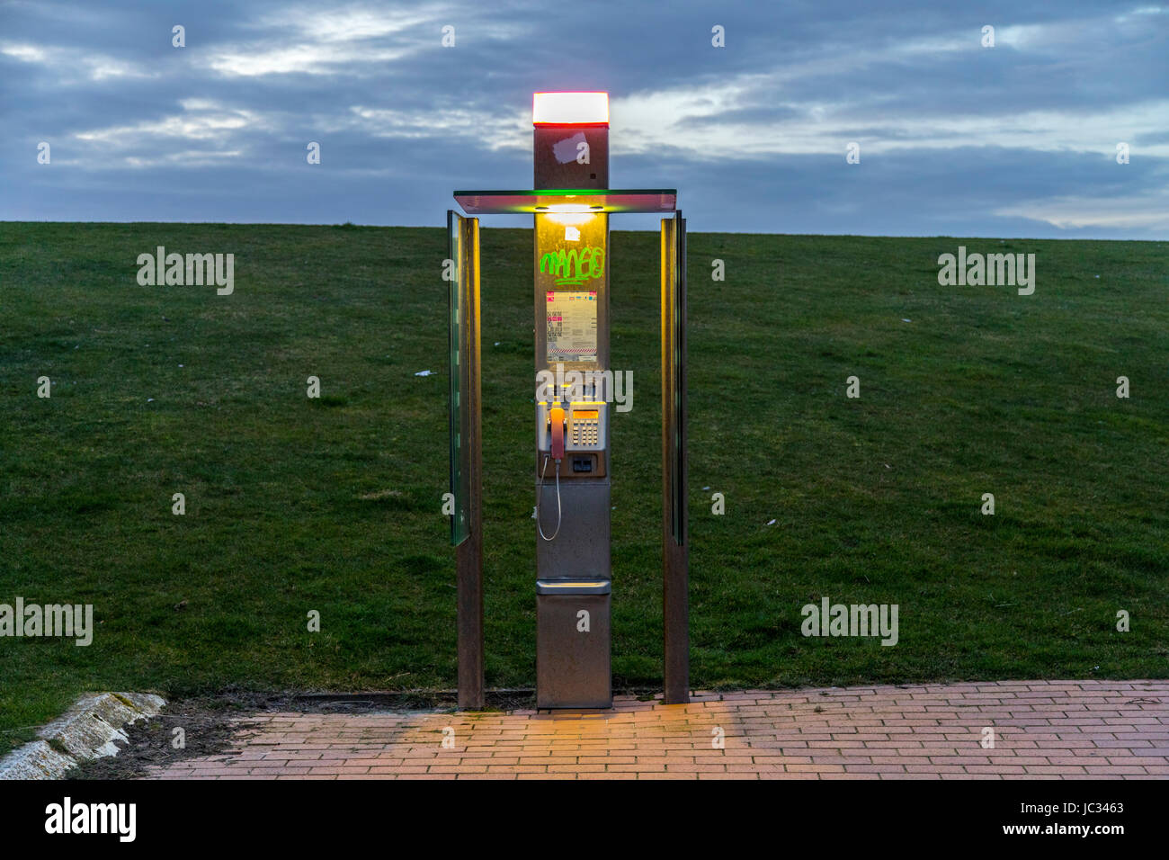 North Sea island, Norderney, East Frisia, Germany, old public phone booth, pay phone, by German Telekom company, - Stock Image