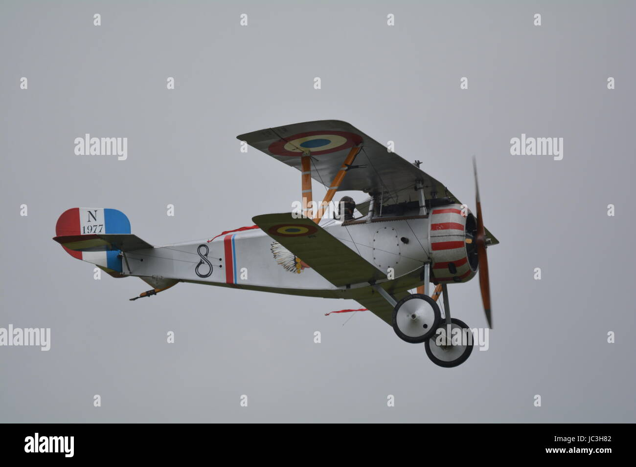 World war 1 fighter bi plane Nieuport 17 replica in hanger at IWM Duxford - Stock Image