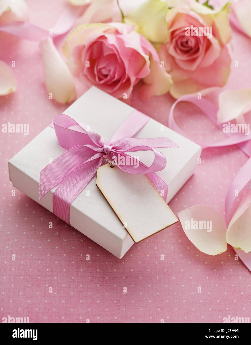 Gift Box Tied With Pink Ribbon Bow Rose Flowers Stock Photo