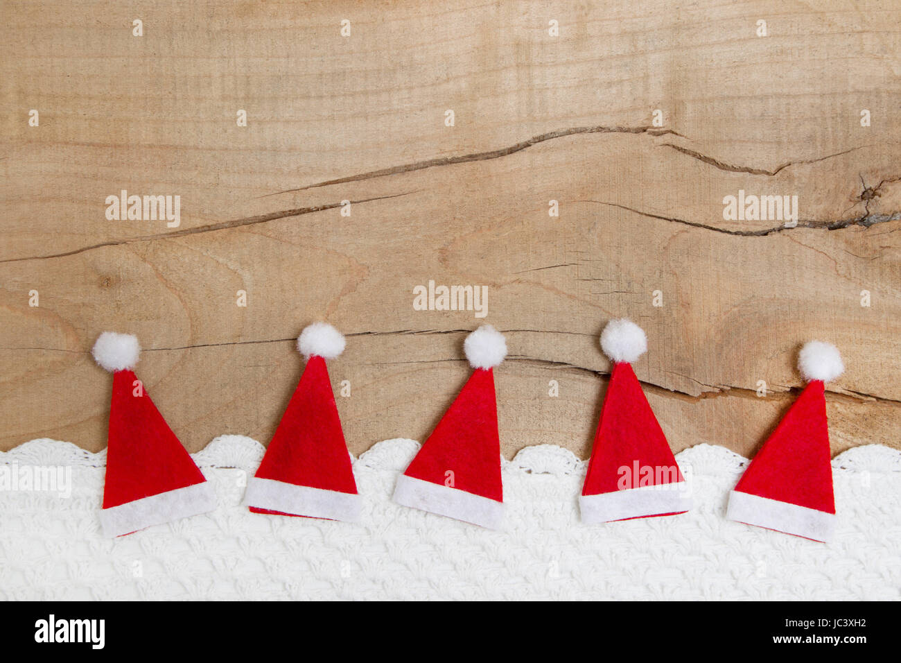 Greeting card idea stock photos greeting card idea stock images red christmas hats on wooden background for a greeting card idea for natural decoration m4hsunfo