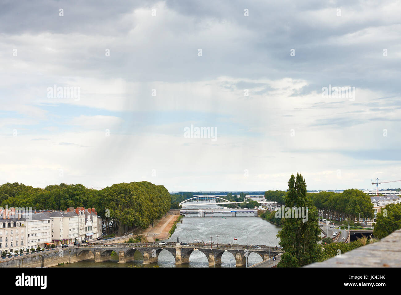 view of bridges Pont de Verdun and Pont de Haute Chaine on La Maine river in Angers, France in rainy day - Stock Image