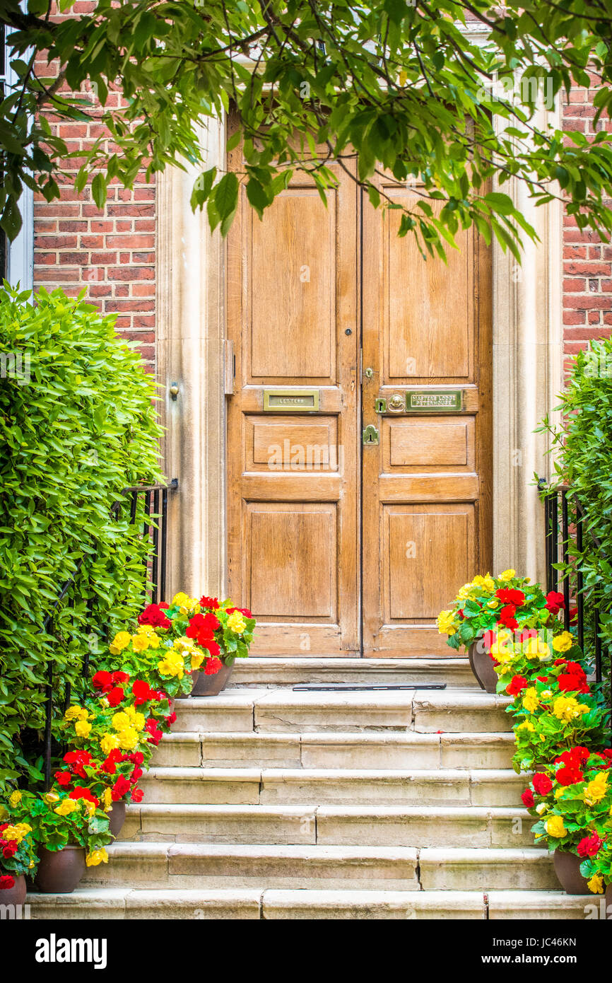 Steps adorned with potted flowers leading to the main entrance of the Master's lodge (home) at Peterhouse college, - Stock Image