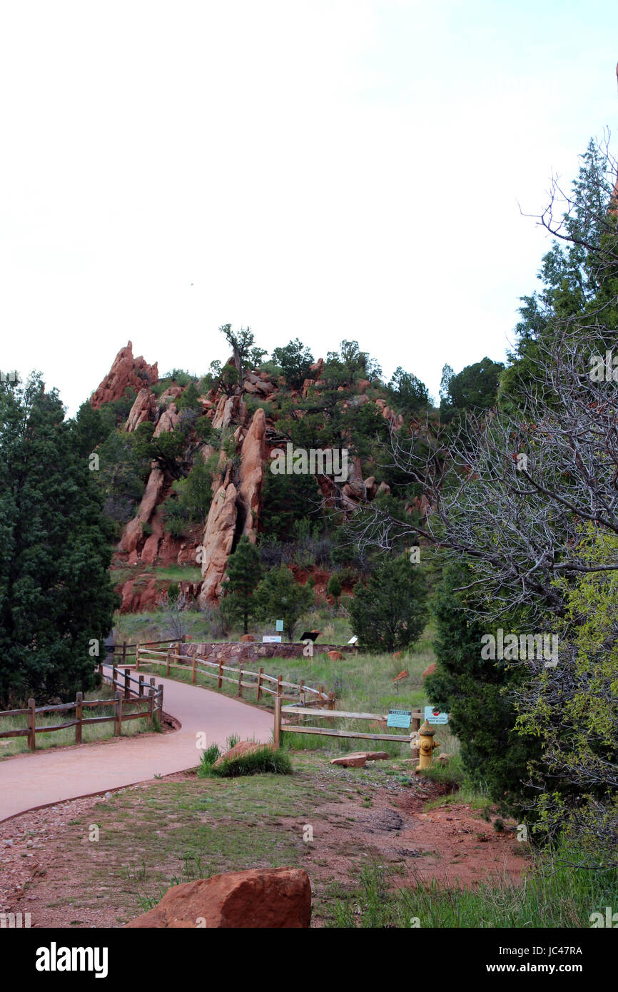 A hiking trail at the Garden of the Gods, Colorado Spring, Colorado, leading to red rock formations - Stock Image