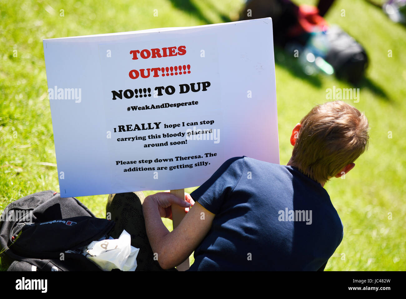 Demonstrators against the Tory DUP alliance gathered in Parliament Square and marched on Downing Street. London. - Stock Image